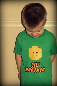 Big Lil' Brother can't stop looking at his really cool shirt!