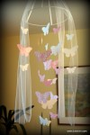 Baby's mobile with fluttering butterflies.